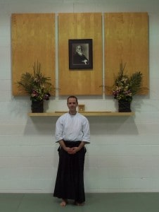 Shane standing at the Jiai Aikido Kamiza in San Diego